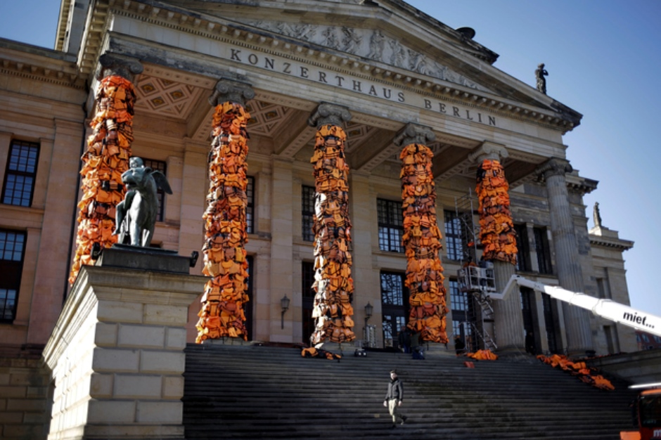 A art installation by Chinese artist Ai Weiwei with discarded life jackets collected at the Greek island Lesbos is set up at the Konzerthalle Berlin (Concert Hall Berlin) for the Cinema For Peace gala alongside the 2016 Berlinale Film Festival in Berlin, Saturday, Feb. 13, 2016. The charity gala will take place at the Konzerthaus at the Gendarmen Markt place on Monday, Feb. 15, 2016. (AP Photo/Markus Schreiber)