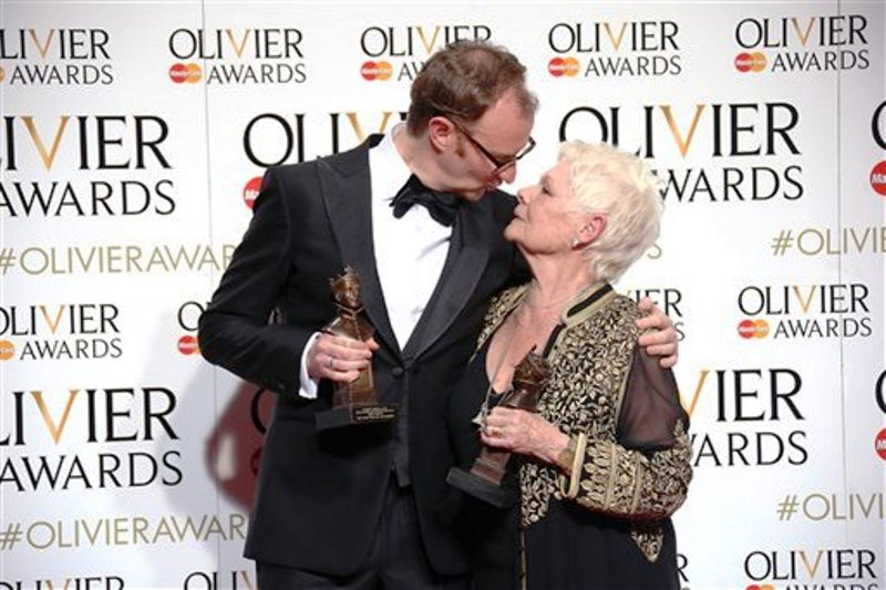 Actors Mark Gatiss, left, with his Best Actor in a Supporting Role award for his performance in the play 'Three Days in the Country' and Dame Judi Dench with her Best Actress in a Supporting Role award for her performance in the play 'The Winter's Tale' at the Olivier Awards in London, Sunday, April 3, 2016. (Photo by Joel Ryan/Invision/AP)